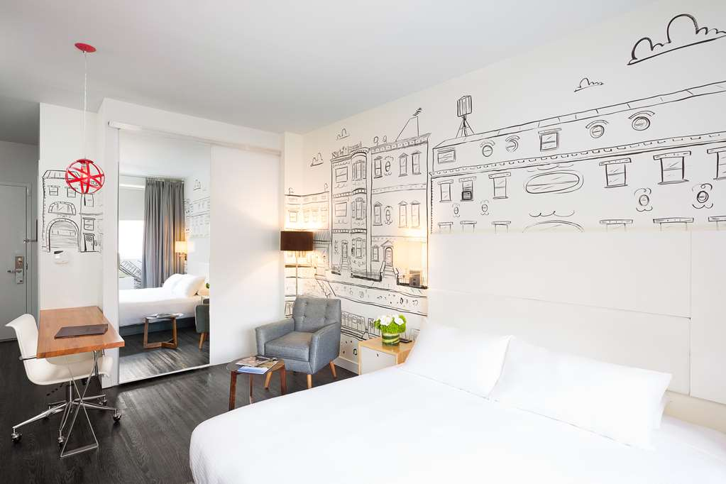 NU Hotel King Bed with Local Mural Perspective