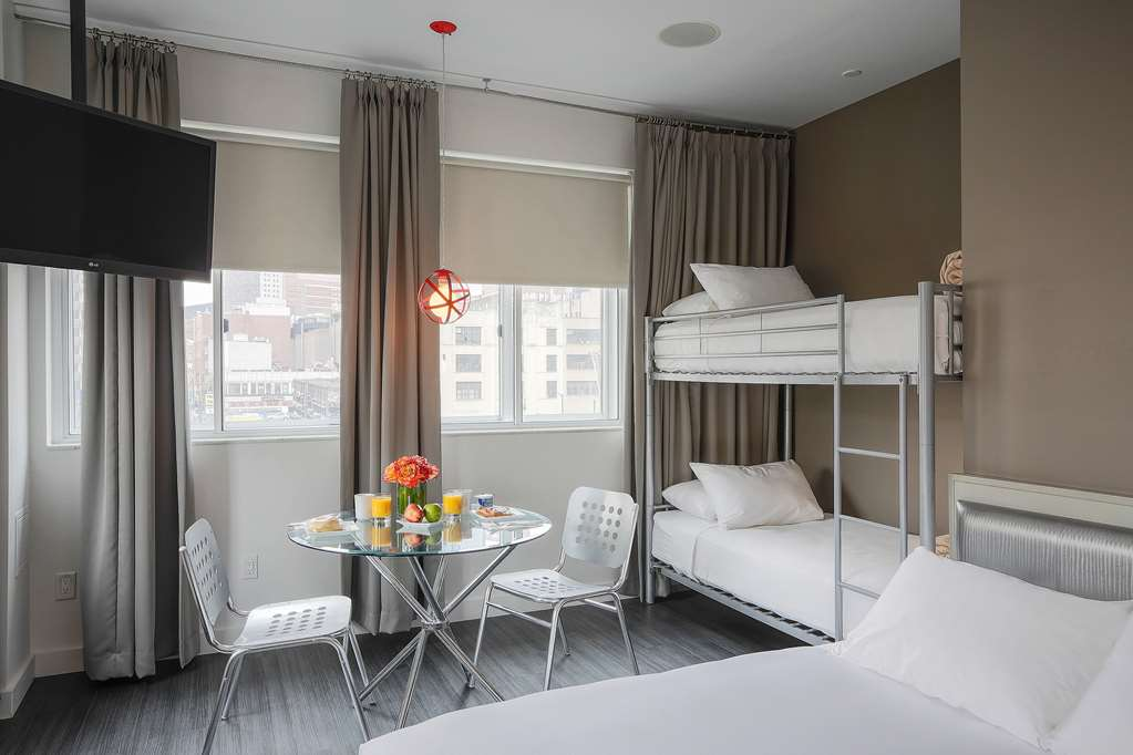 NU Hotel Queen Bed and Twin Bunk Bed Suite