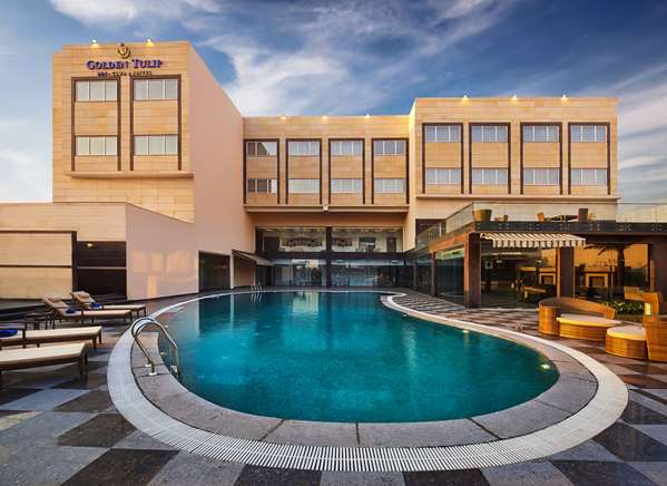 View of the hotel Bhiwadi GOLDEN TULIP BHIWADI. The hotel includes the following equipment: Air condition available, Secure parking, Parking, Public area free wifi.