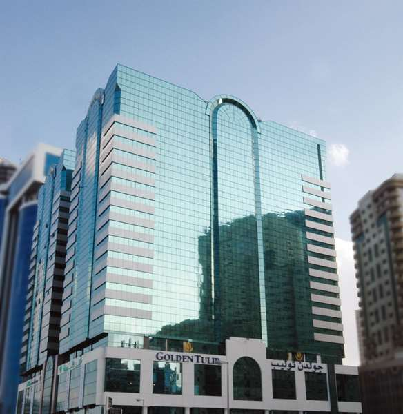 View of the hotel Sharjah GOLDEN TULIP SHARJAH. The hotel includes the following equipment: Air condition available, Parking, Public area free wifi, Pool indoor.