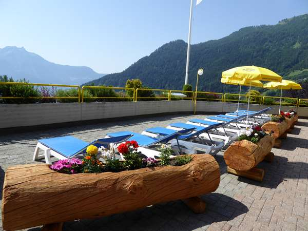 View of the hotel Ovronnaz TULIP INN BAINS D'OVRONNAZ - RESORT. The hotel includes the following equipment: Secure parking, Pool heated outdoor, Pool indoor.