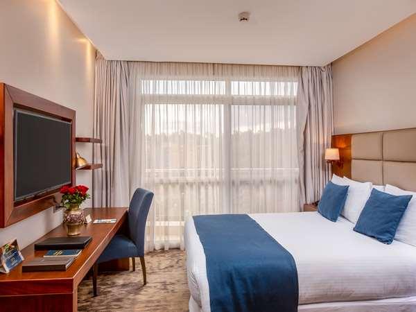 Hotel GOLDEN TULIP CANAAN KAMPALA - Deluxe Room - Queen Bed Balcony